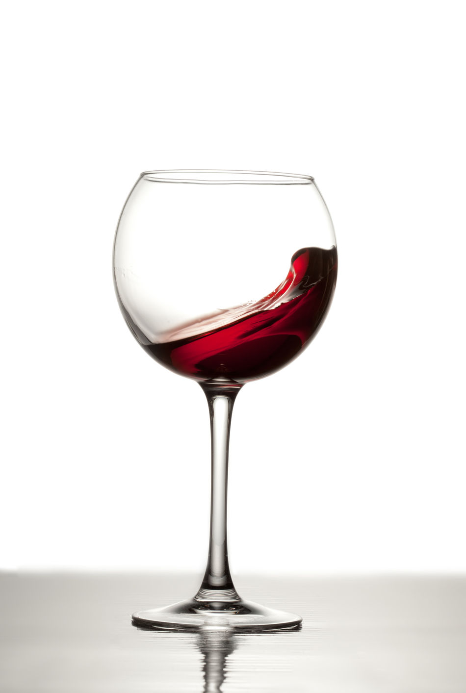 Playing with splashes Alcohol Close-up Drinking Glass Food And Drink No People Red Wine Studio Shot White Background Wine Wineglass Winetasting