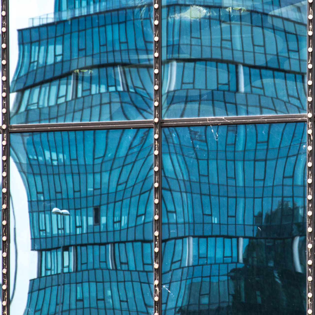 Gent Belgium - Blue Towers glass facade distortion Architectural Feature Architecture Backgrounds Blue Building Built Structure City City Life Day Distortion Gent Belgium Geometric Shape Glass - Material Glass Facades Low Angle View Modern No People Fine Art Photography Outdoors Reflection Sky Skyscraper Tall - High Urban Geometry Premium Collection