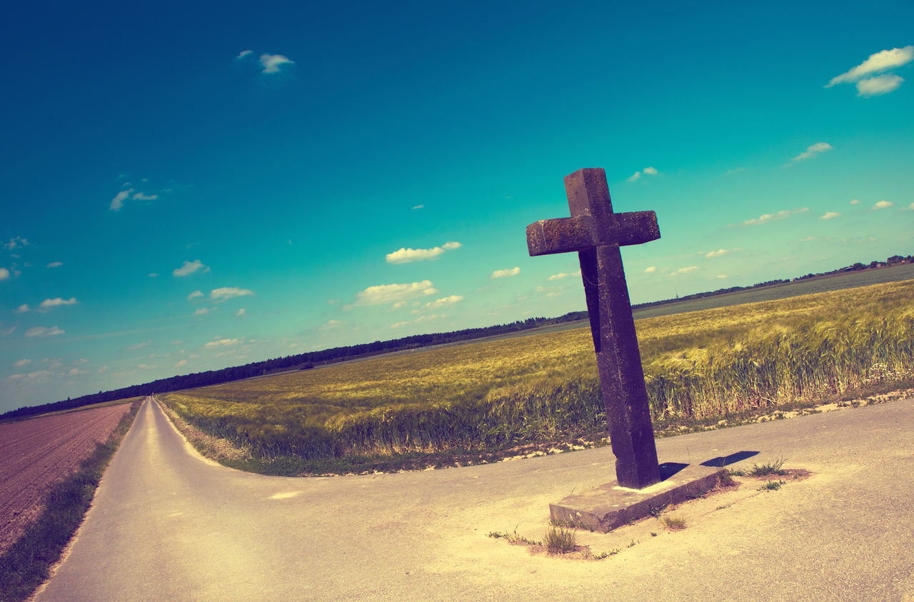 Believe Blue Catholic Christianity Colorful Cross Crossroads Crucifix Day Death Fields Horizon No People Outdoors Religion Religion And Faith Sky Stone Cross Summer Sunlight Symbol Tradition Way Way To Go Home