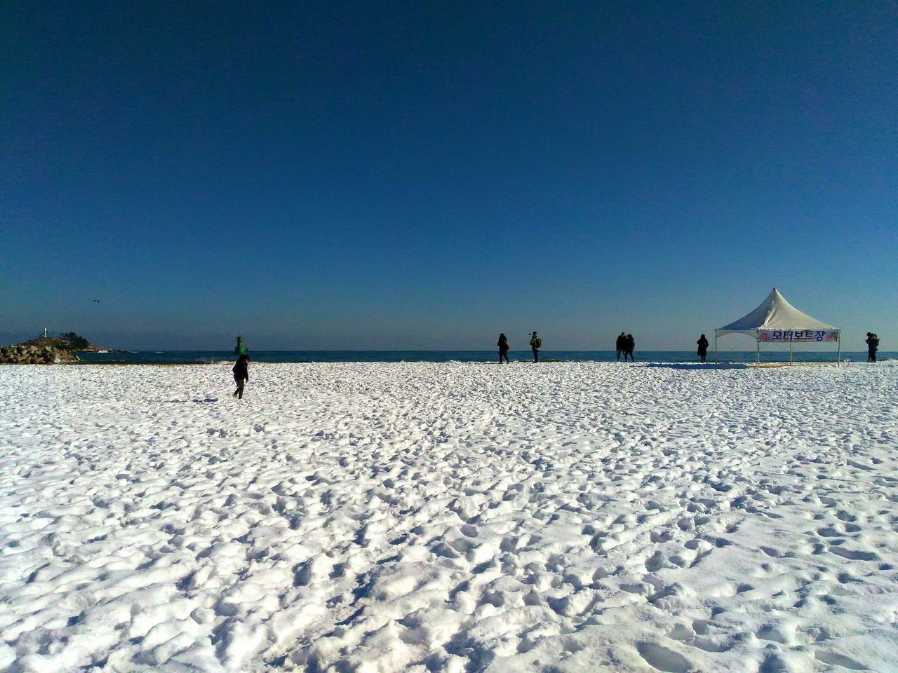 Snow sand Nofilter No Edit/no Filter Sand Beach Sky Cold Temperature Blue Winter Nomadic Wanderlust Sky And Sea Sightseeing Beautyofnature Wonderful World Travel Seascape Landscape Land Sokcho Beach South Korea Gangwon-do