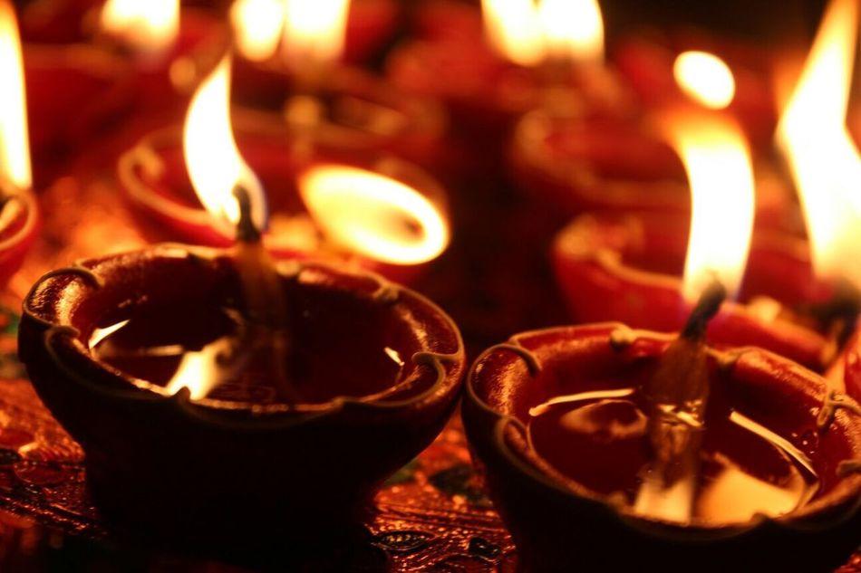 Maximum Closeness Diwali Indianfestival Light Close-up Photographylovers Nikon No People Close Up Light And Reflection Illuminated Indiandairies Reflection Nofilter Orange Color Shadow Indian Culture  Diya - Oil Lamp