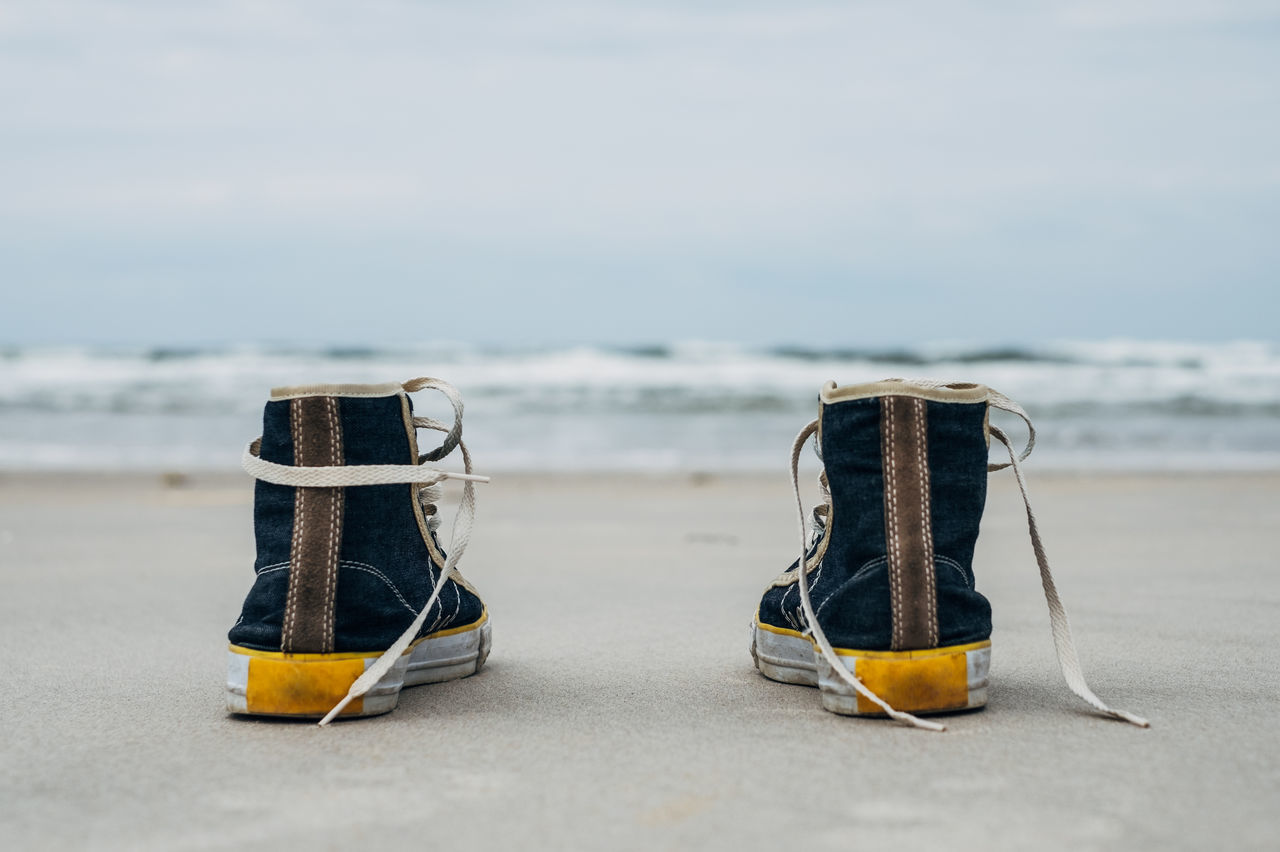 Sneakers on the beach Baltic Baltic Sea Beach Copy Space Cover Creative Focus On Foreground Friends Fun Happy Horizontal Composition Lonly Love Nature No People Outdoors Sea Sea And Sky Selective Focus Shoes Sky Sneakers Still Life Summertime View