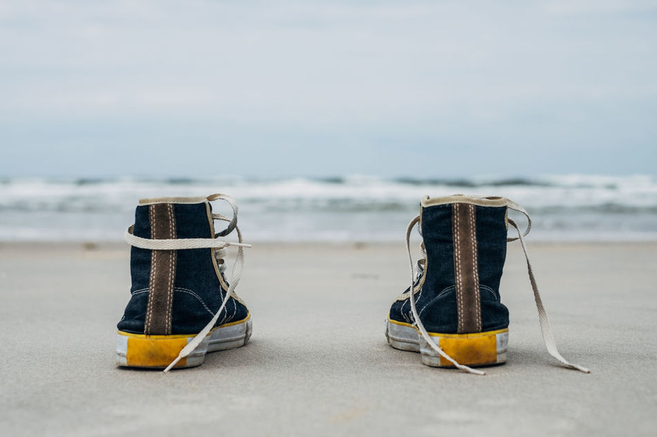 Beautiful stock photos of shoe,  Beach,  Beauty In Nature,  Canvas Shoe,  Close-Up