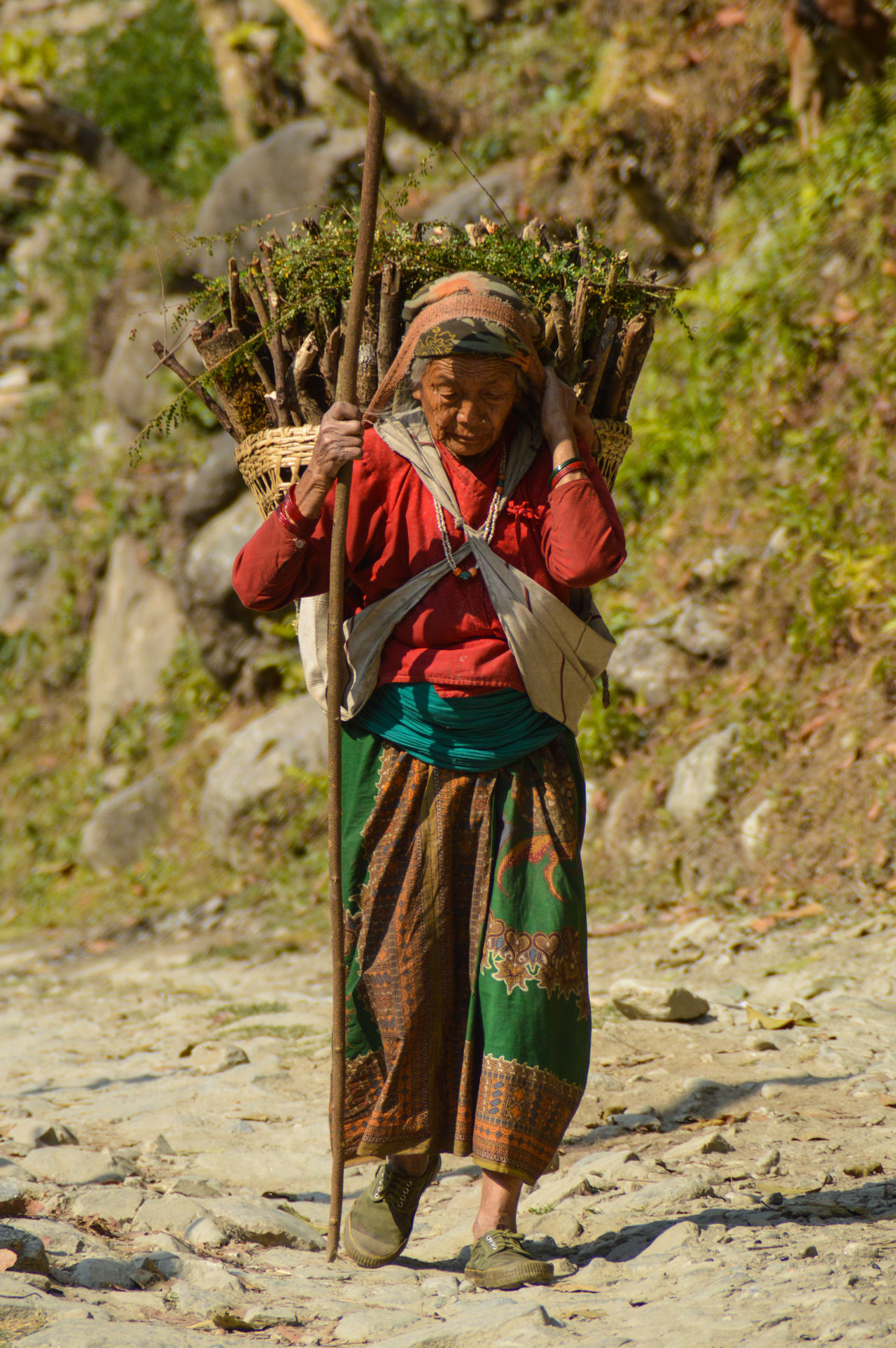 Outdoors One Person People Day Close-up Adult People Of Nepal Travel Destinations Travel Travel Photography People Photography Traditional Clothing Women Of Nepal Culture And Tradition Woman At Work Countryside Tradition Nepal Women Carrying Heavy Loads Women At Work Miles Away