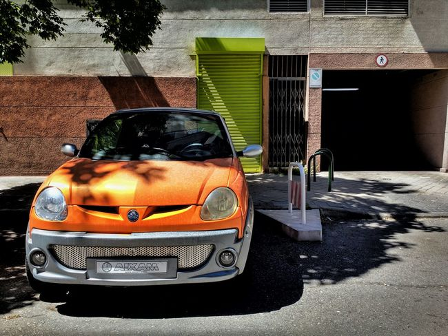 Orange Green Small Car Orange And Green Streetphotography Street Photography Having A Walk Garage Parking Colour Of Life