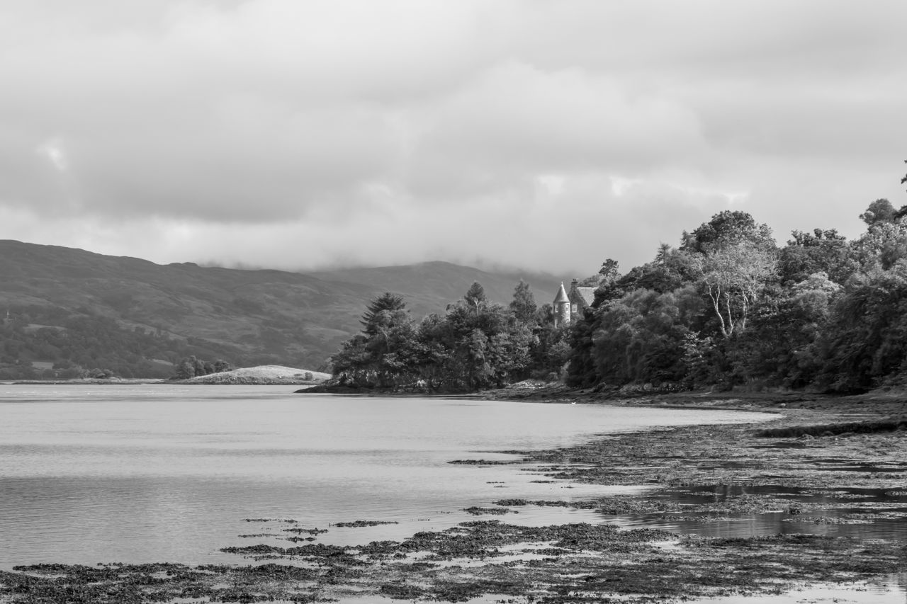Isle of Mull, Scotland - small castle seen in between the trees at the shore of a lake, black and white Black & White Blackandwhite Blackandwhite Photography Castle Cloud - Sky Day Lake Monochrome Outdoor Photography Outdoors Scenics Scotland Sky Tranquil Scene Tranquility Tree Water