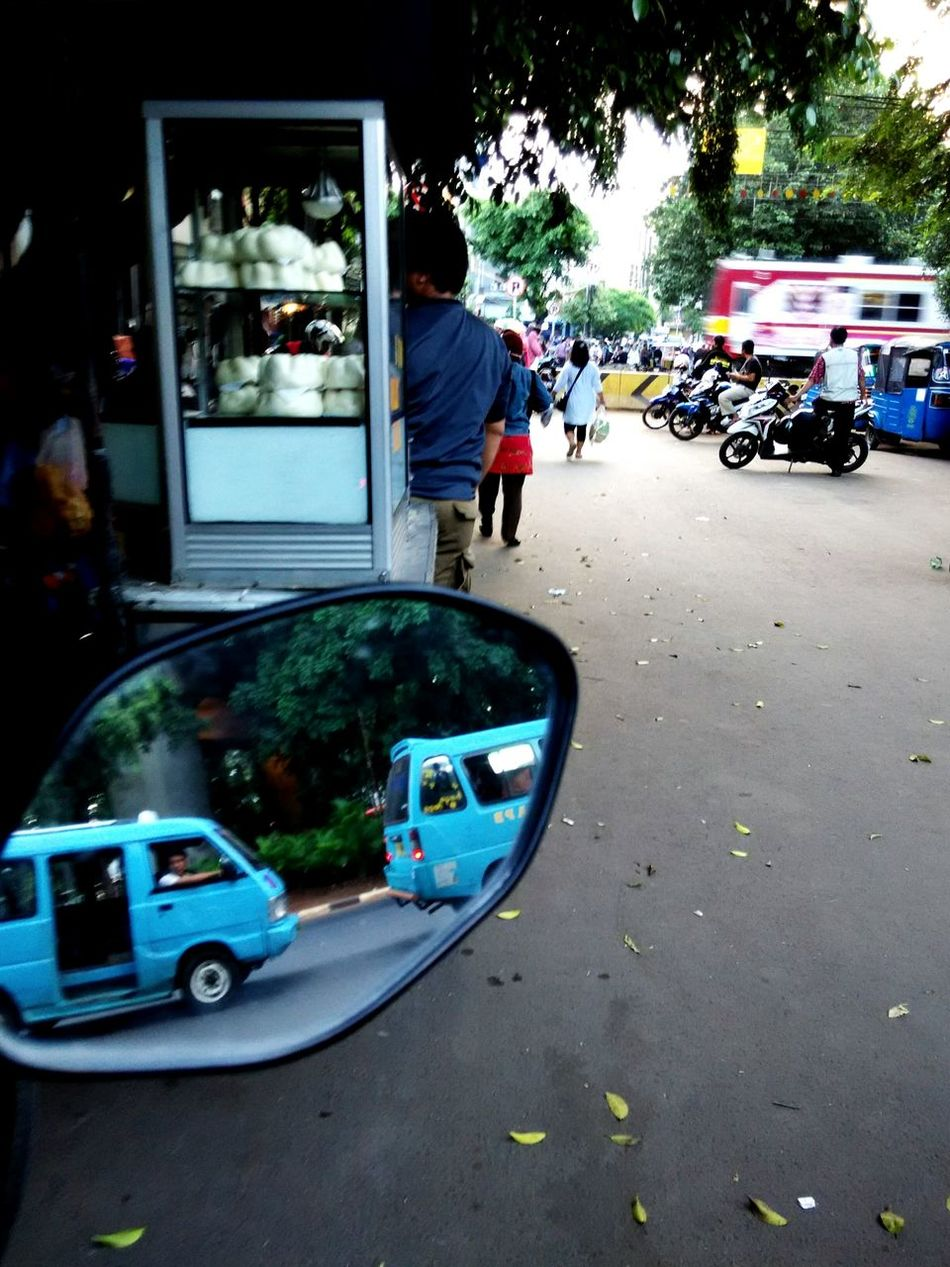 Closed train crossing with Ex-japan railway commuter train passing throughTaking Photos Streetphotography Commuter Train Streetvendor Traffic JakartaStreet Reflection Check This Out Motorcycles Angkot Up Close Street Photography Human And Technology Human Meets Technology Jr