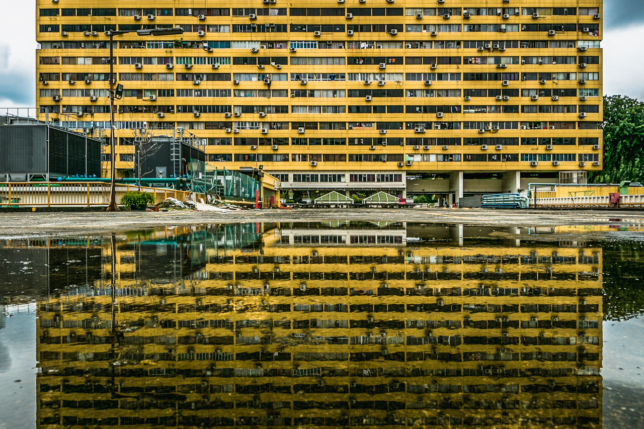 Symmetry Architecture Building Building Exterior Built Structure City Day Eyeem Philippines Flood Modern No People Outdoors Reflection Symmetry Water We Yellow Yellow Flower