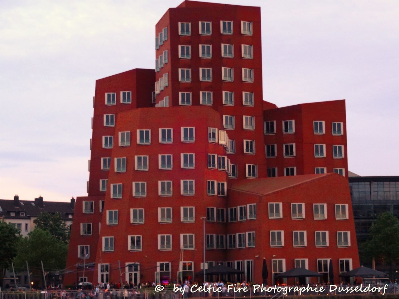 architecture, building exterior, built structure, city, red, outdoors, sky, large group of people, day, residential, people