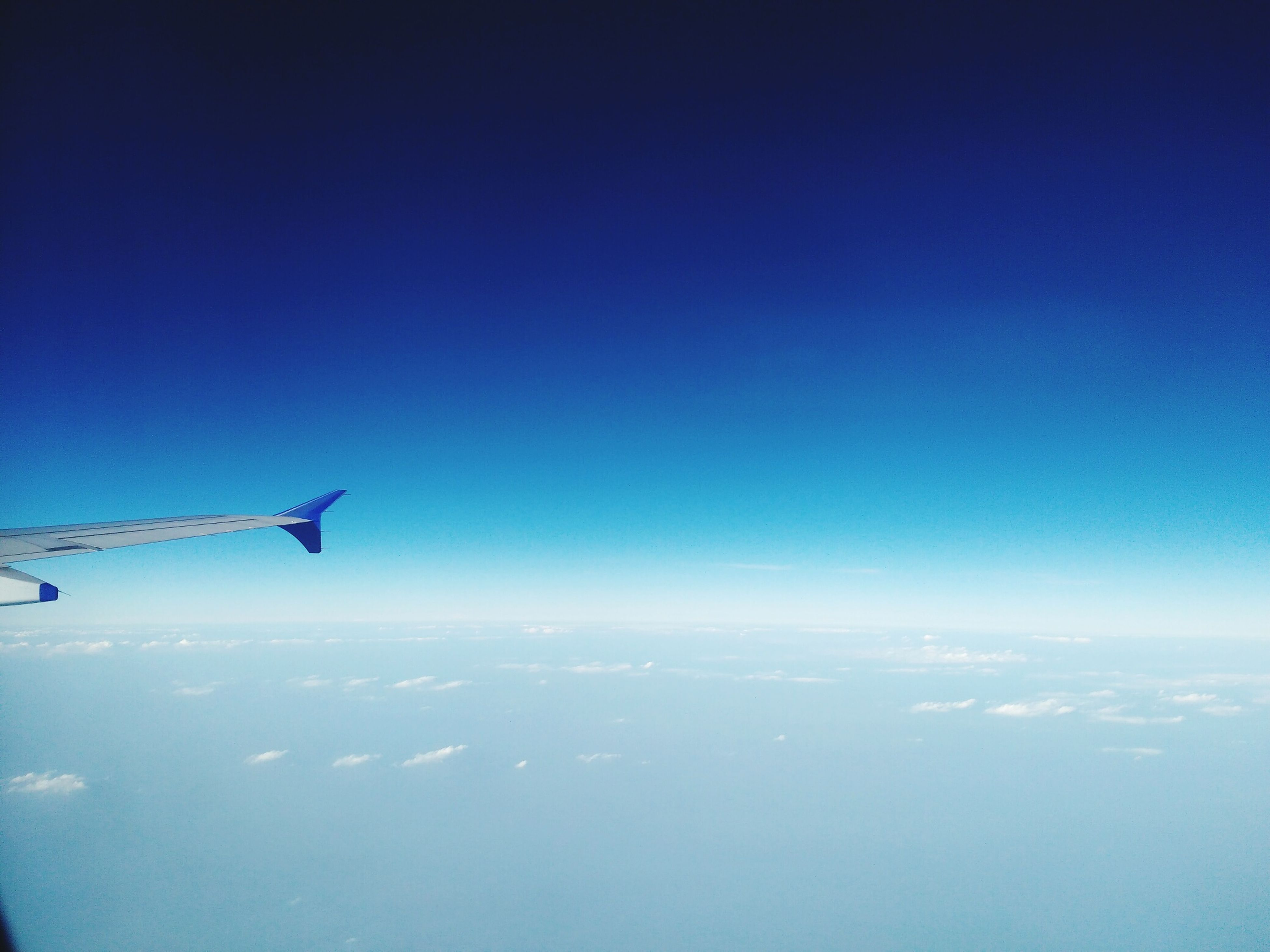 flying, airplane, blue, air vehicle, transportation, mode of transport, scenics, mid-air, aerial view, beauty in nature, aircraft wing, copy space, nature, tranquil scene, travel, tranquility, clear sky, journey, sky, landscape