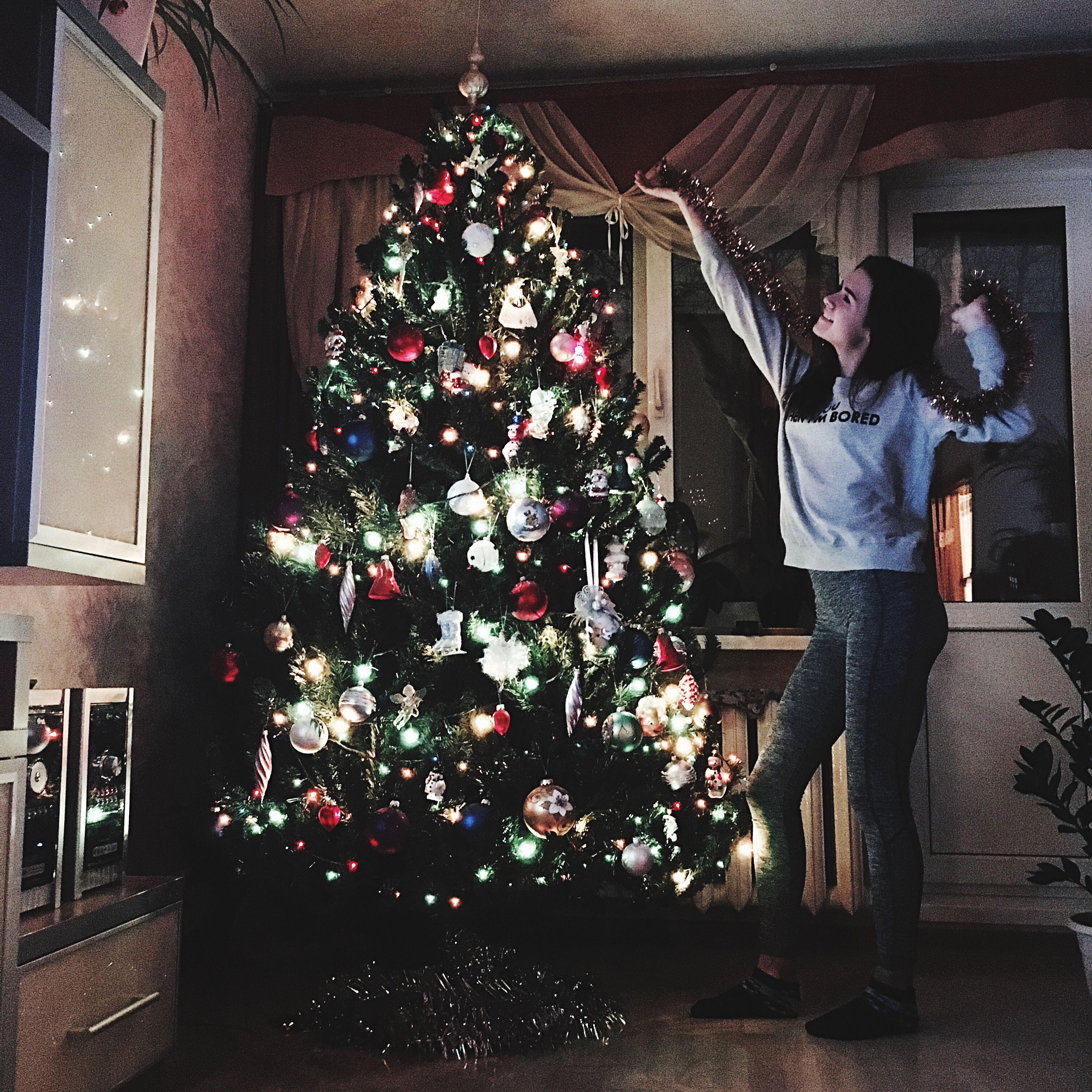 christmas, christmas tree, celebration, christmas decoration, tree, christmas ornament, two people, illuminated, christmas present, holiday - event, adults only, christmas lights, wineglass, gift, happiness, people, living room, house, indoors, wine, women, event, alcohol, adult, young adult, advent