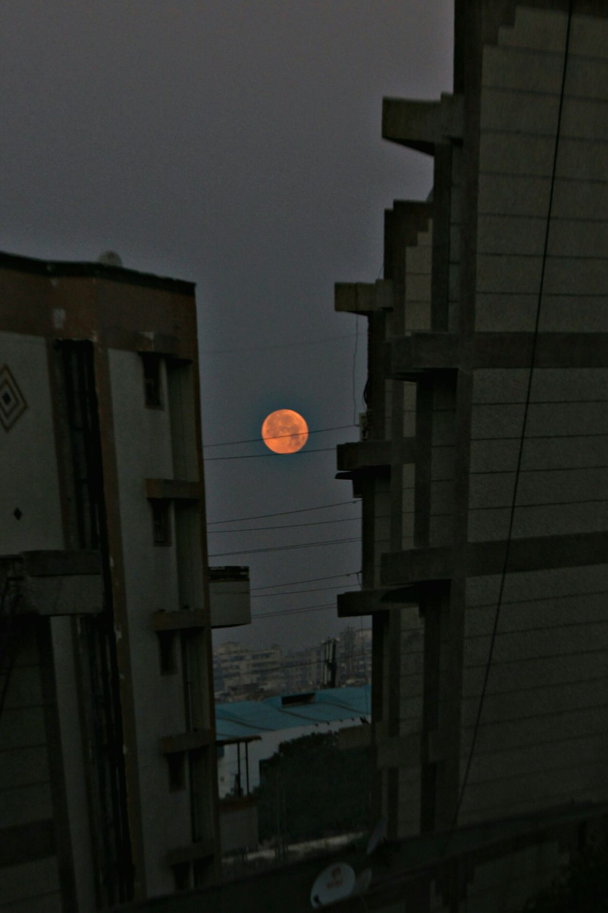 The Great Outdoors With Adobe Clicking Photos Early Morning Moon Shots Red Moon Peaceful View Check This Out Get Outdoors Balcony View Amazing Moon Amazing Mood Gorgeous View Residential Building Between Buildings Urban Lifestyle Urban Exploration Modern Architecture The Great Outdoors - 2016 EyeEm Awards The Great Outdoor With Adobe Beautiful View Found On The Roll Cities At Night Nature's Diversities 43 Golden Moments