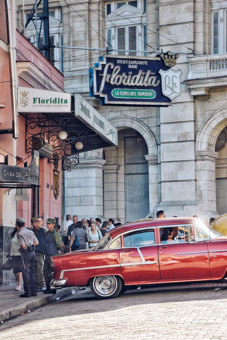 """My mojito in La Bodeguita, My daiquiri in El Floridita."" - Ernest Hemingway Architecture Building Exterior Car Transportation Real People Built Structure Street Mode Of Transport Lifestyles City Life Road Sign Cuba Havana Chevy 1950's Neon Neon Sign Bar Pub Streetphotography Classic Car"