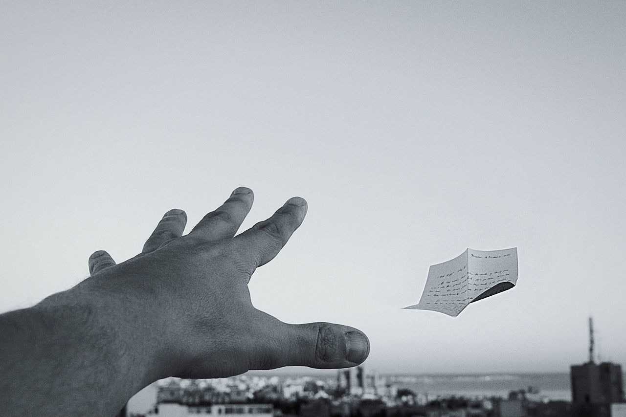 The farewell letter Blackandwhite Clear Sky Conceptual Creativity Getting Inspired Hand Human Hand Letter Monochrome White Background Telling Stories Differently My Favorite Photo Long Goodbye Monochrome Photography