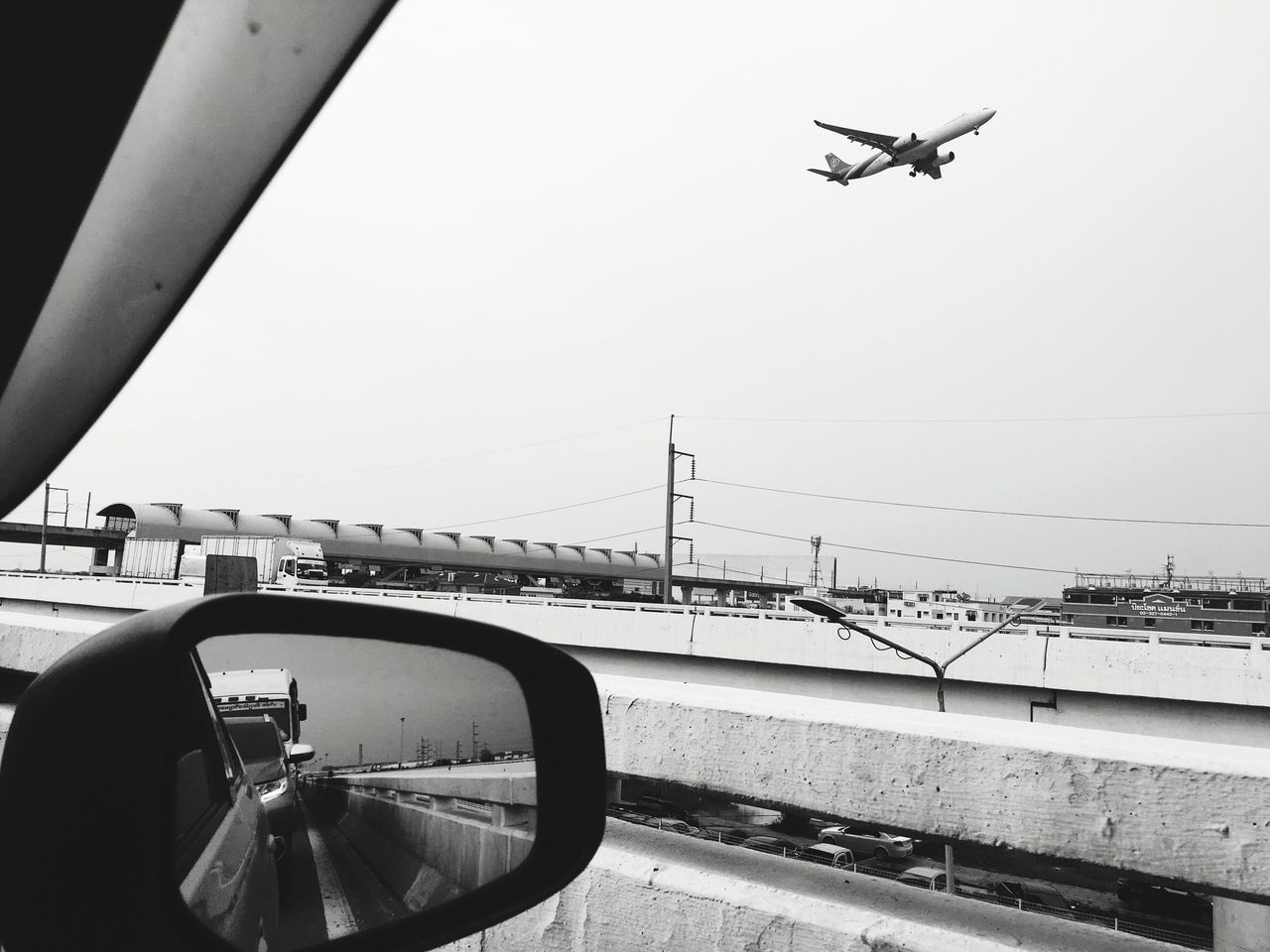 Suwannabhumiairport Transportation Mode Of Transport Flying Air Vehicle Architecture Day Journey Bridge - Man Made Structure Clear Sky Mid-air Built Structure Airplane Road One Person Outdoors Sky Water People Traffic Jam