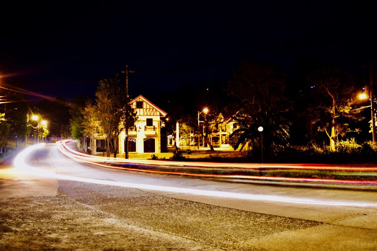 My first take using a tripod and a very slow shutter speed at St. Monique Valais. Illuminated Night Light Trail Long Exposure Speed Road Motion Transportation Street Street Light Blurred Motion High Street Building Exterior No People Outdoors Architecture Urban Scene Tree Clear Sky City The Street Photographer - 2017 EyeEm Awards The Architect - 2017 EyeEm Awards EyeEmNewHere