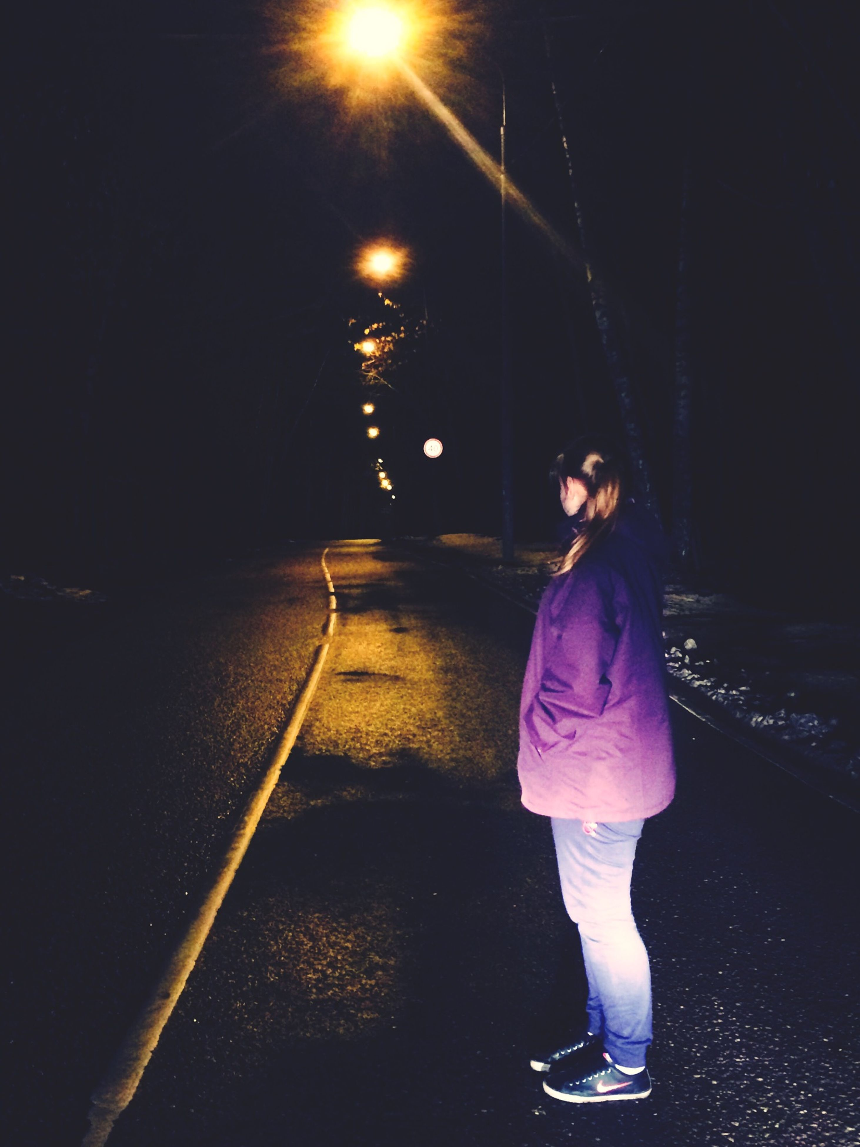 night, lifestyles, full length, standing, illuminated, leisure activity, casual clothing, rear view, street, front view, the way forward, young women, walking, person, road, outdoors, young adult
