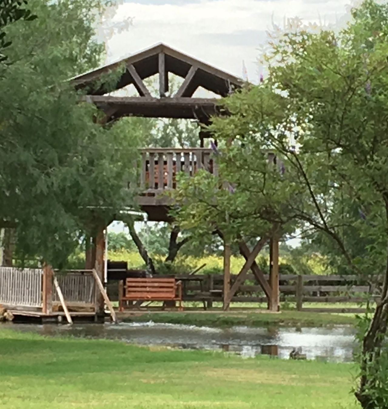 Our party deck and pond in our backyard in south Texas Tree Architecture Built Structure Outdoors Scenics Sky tranquility