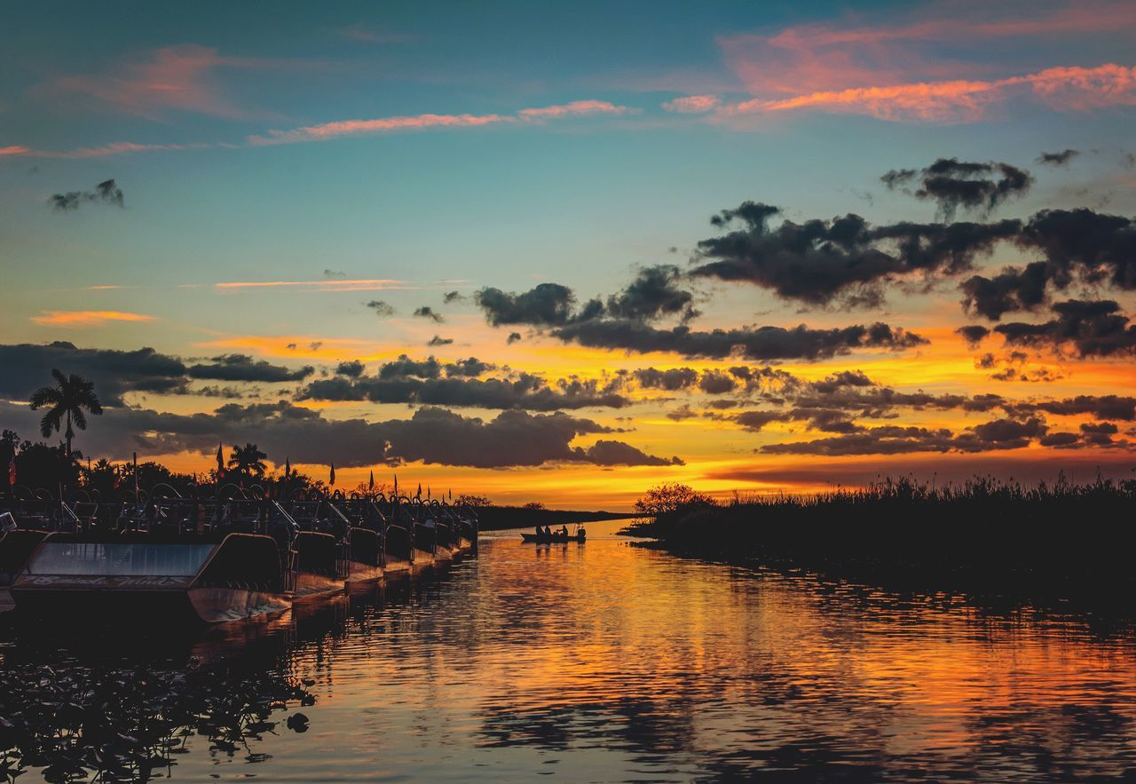 Peaceful Sunset Sky Water Scenics Beauty In Nature Cloud - Sky Nature Reflection Tranquility Tree Tranquil Scene Idyllic Silhouette Outdoors Sea No People Day
