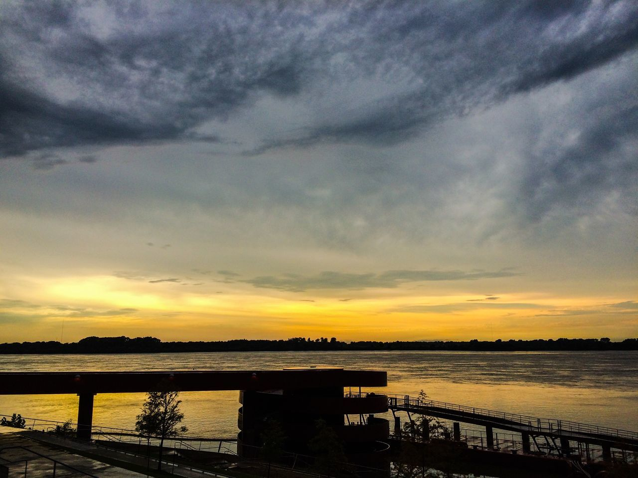 sunset, sky, water, cloud - sky, built structure, bridge - man made structure, silhouette, river, scenics, outdoors, architecture, no people, nature, tranquility, beauty in nature, tree, day