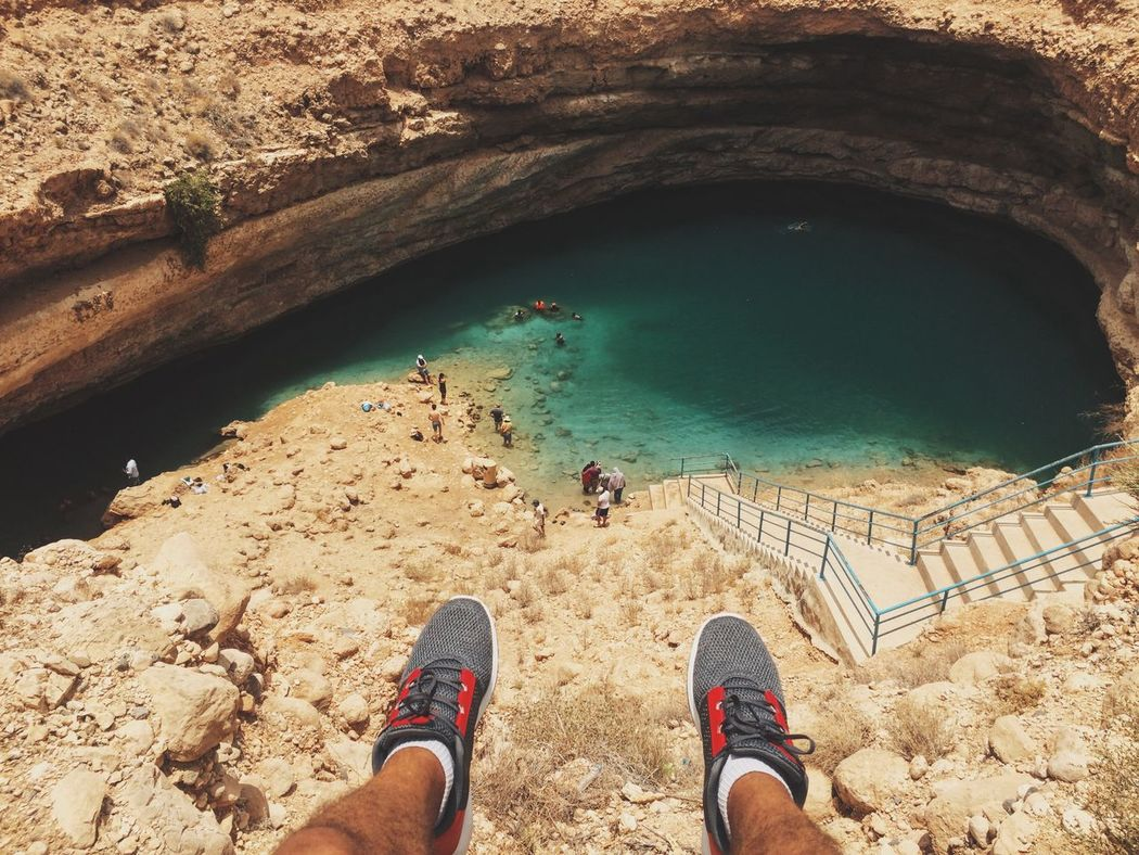 Beauty In Nature Bimmah Sinkhole Day Human Leg Leisure Activity Lifestyles Low Section Nature Oman One Person Outdoors Personal Perspective Real People Water Out Of The Box Sommergefühle