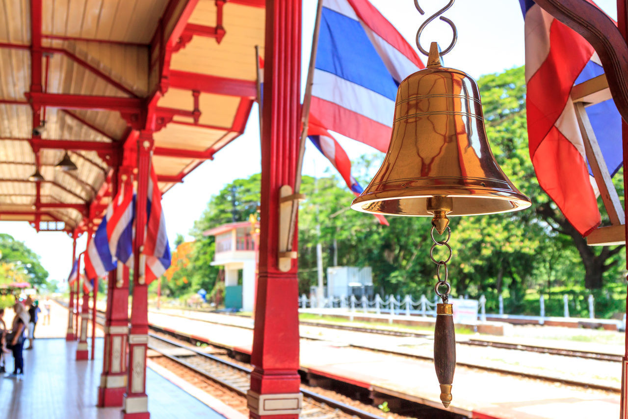 Hua Hin train station's bell and Thai flag Architecture Arrival Bell Built Structure City City Life Commuter Country Countryside Day Flag Hanging Journey No People Railway Station Railway Station Platform Ring Station Thai Culture Thai Flag Thailand Train Station Travel
