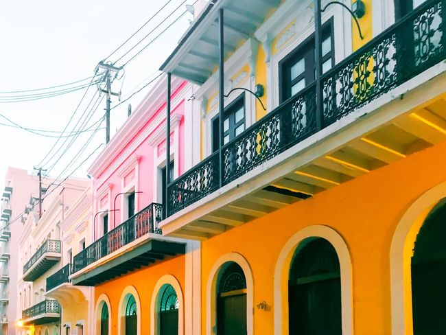 Architecture Built Structure Yellow Building Exterior Public Transportation Low Angle View City Arch Day Sky Outdoors No People City Life Power Line  Public Transport Multi Colored TakeoverContrast Puerto Rico City Cityscapes