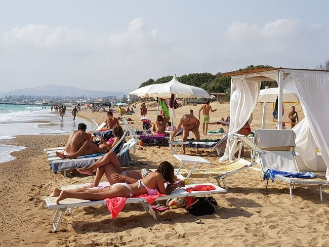 Beach Sand Sea Large Group Of People Vacations Enjoyment Relaxation Fun Leisure Activity Sitting Outdoor Chair Summer Mid Adult Men Outdoors Chair Adult Day People Lifestyles Sky Agrigento Sicily