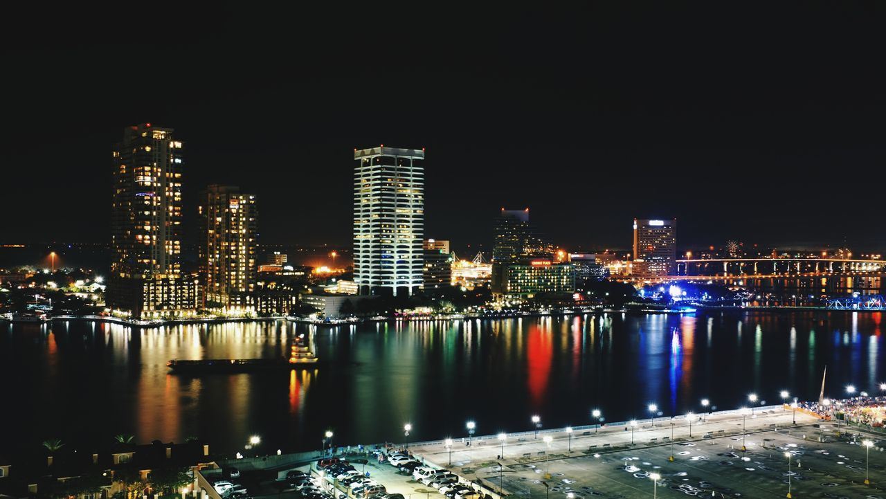 Jacksonville, Florida skyline. Architecture Building Exterior Built Structure City City Life Cityscape Development Financial District  Illuminated Jacksonville Florida JacksonvilleFL Modern Night No People Office Building Outdoors Sea Sky Skyscraper Tall Tall - High Urban Scene Urban Skyline Water Waterfront