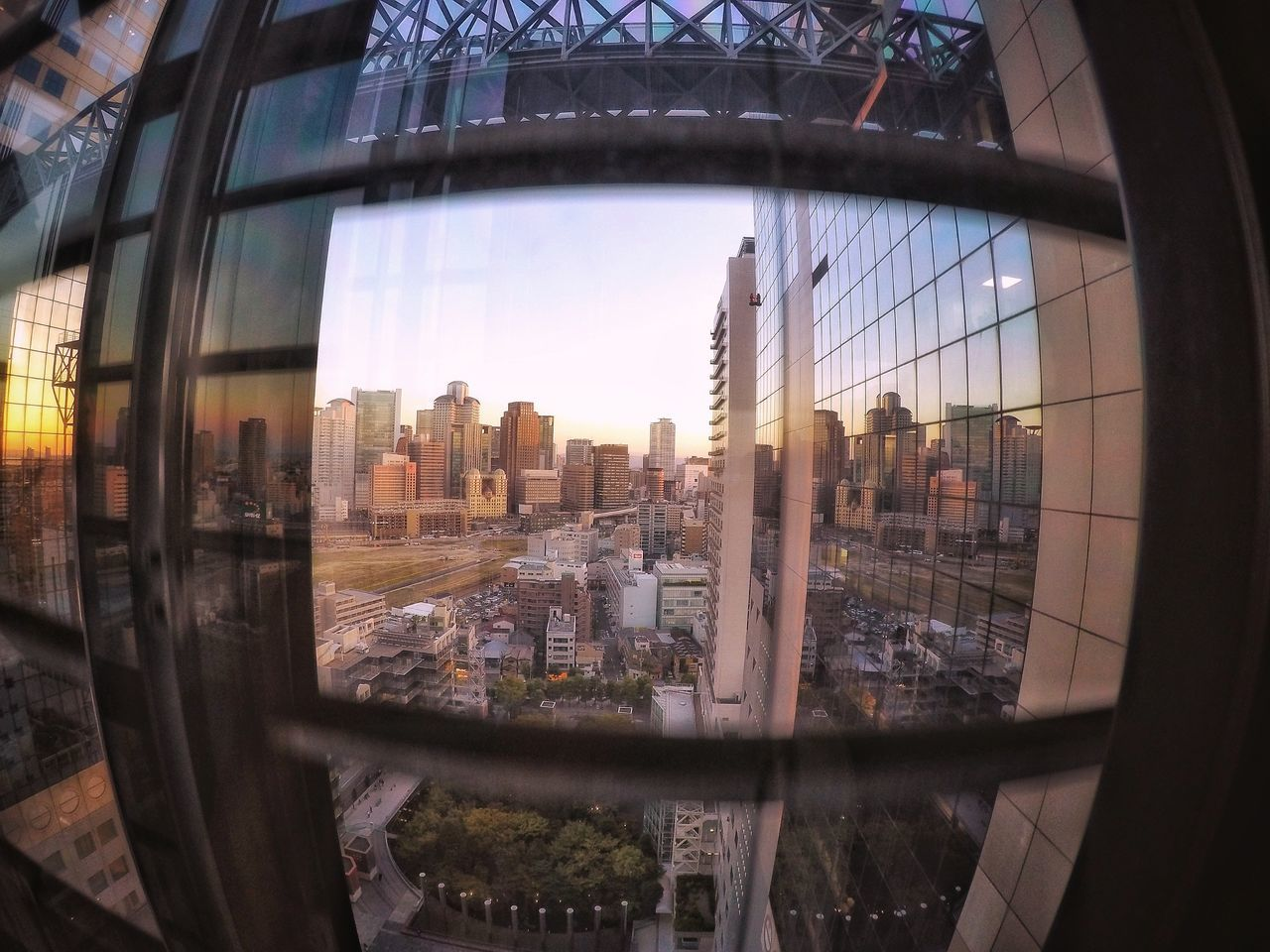 In The Elevator From My Point Of View OSAKA Cityscape Sunset Elevator Window View Reflection Window Reflections Buildings Building Exterior Buildings & Sky Geometric Shapes Architecture Perspective Light And Shadow Travel Photography Capture The Moment GoPrography EyeEm Best Shots EyeEm Best Edits