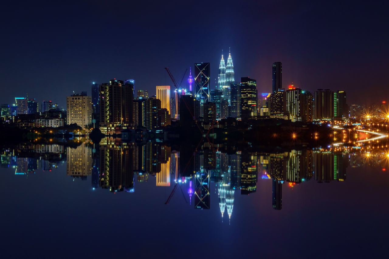 Reflection Of Illuminated Built Structures In River