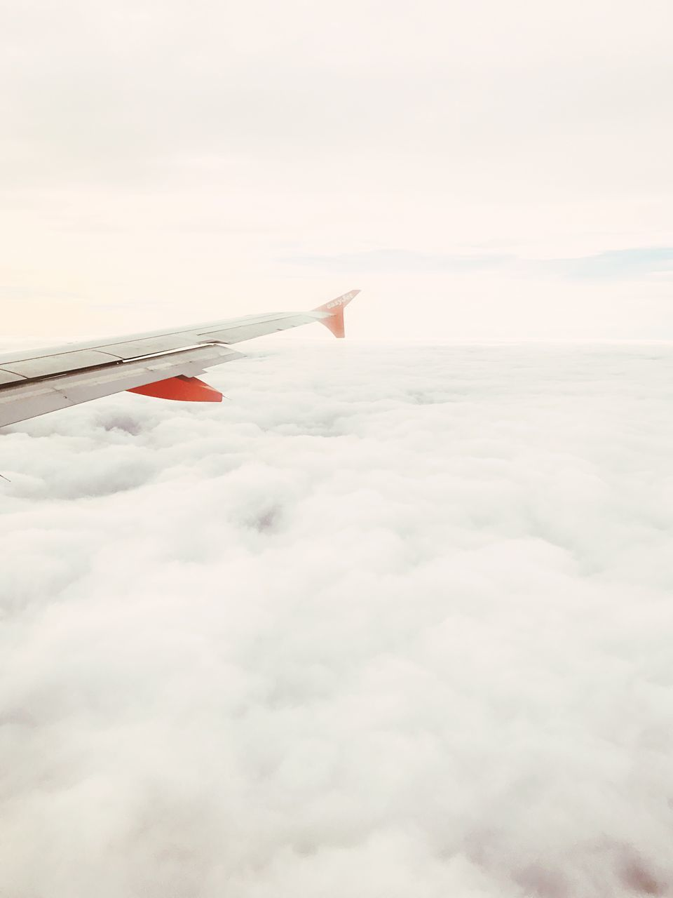 airplane, cloud - sky, sky, transportation, airplane wing, journey, aerial view, cloudscape, travel, air vehicle, aircraft wing, flying, nature, no people, mid-air, mode of transport, beauty in nature, outdoors, scenics, day, vehicle part