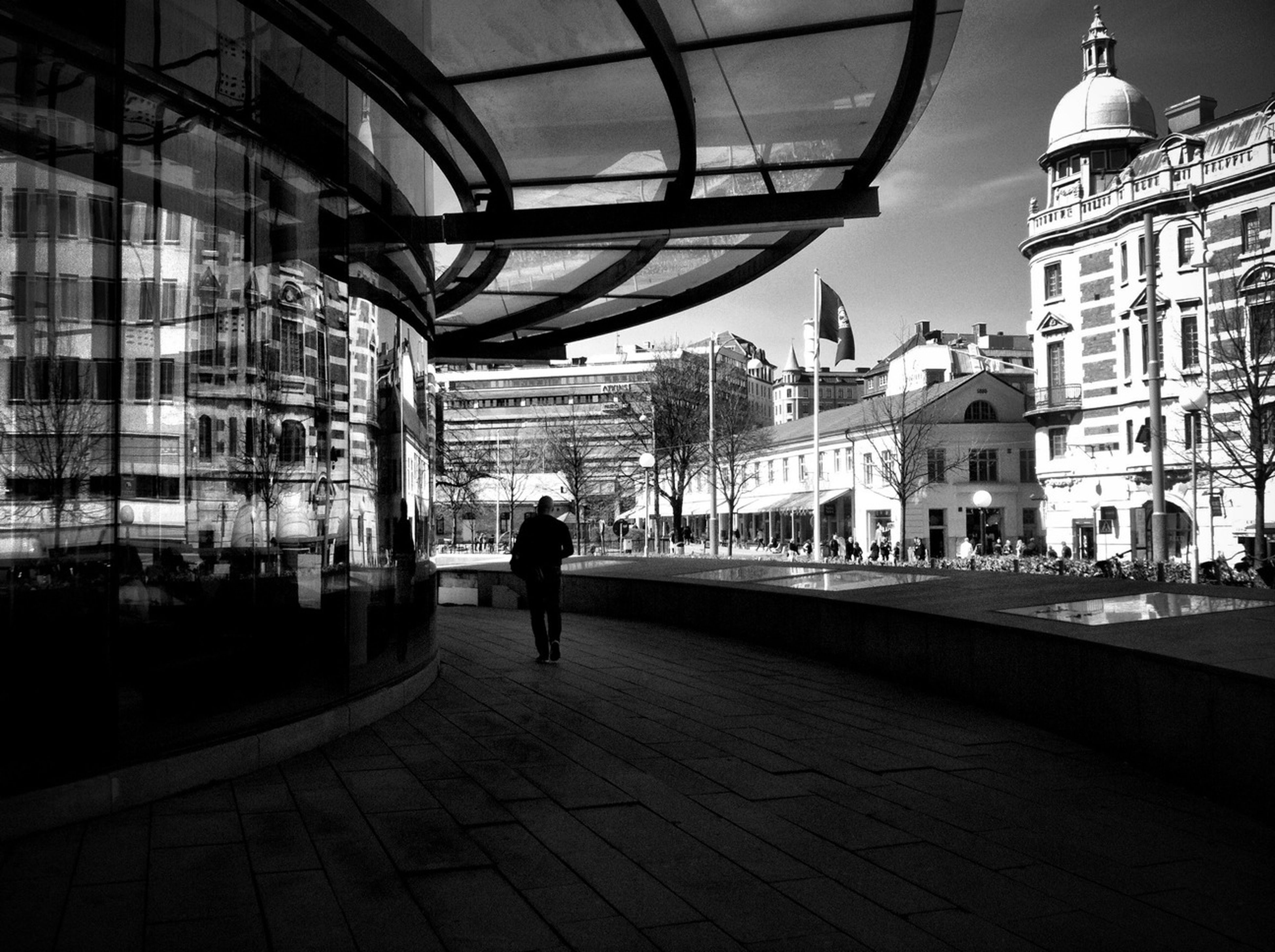 architecture, building exterior, built structure, walking, city, full length, men, rear view, lifestyles, street, city life, person, cobblestone, building, the way forward, incidental people, transportation, day