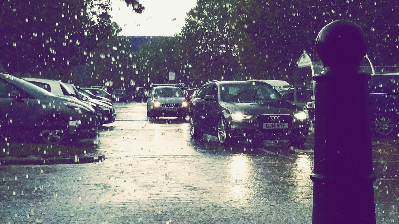 car, rain, wet, rainy season, land vehicle, mode of transport, transportation, water, street, road, day, outdoors, real people, sky