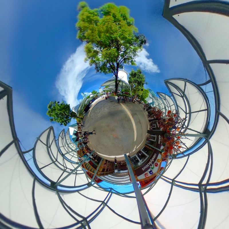 Architecture The City Light Architecture_collection Ball Blue City Day Distorted Image Fish-eye Lens Leaves Magic No People Outdoors Planet Planet Earth Resort RICOH THETA Round Selfie Sentosa Sky Skyline Tourism Tree Tree