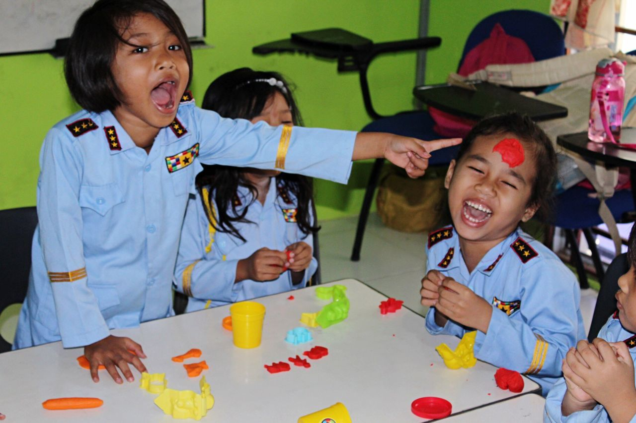 Girl Power Volunteering during my traveling in Southeast Asia it was one of the most memorable experiences. I had a wonderful time teaching art & craft classes in Batam island, Indonesia. These little girls were extremely energetic and creative. Girls Children Children Photography Crafts Play Time Play Dough Kids Being Kids Fun Fun Time School Indosesia Batam Island Laughing Cheeky