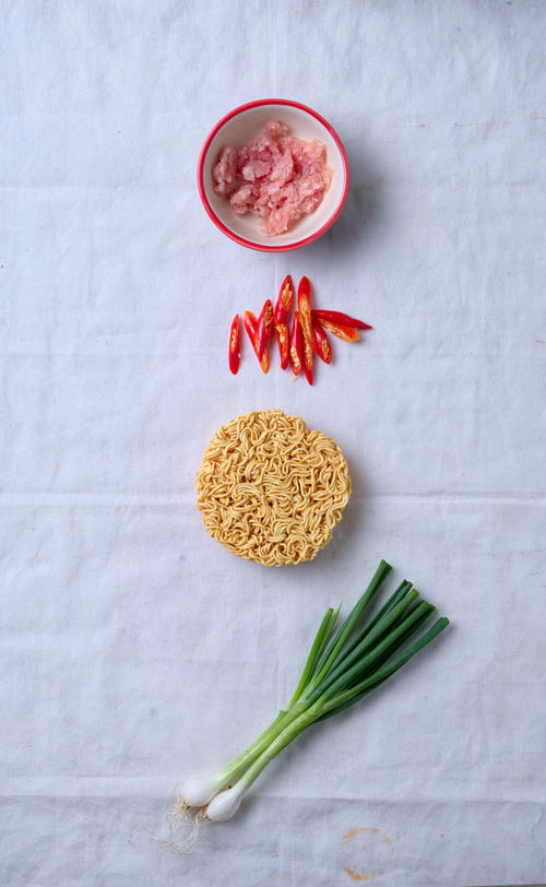 Arrangement Close-up Food And Drink Freshness Healthy Eating High Angle View Indoors  Ingredient Instant Noodle Minced Meat No People Noodle Ready-to-eat Red Chili Pepper Shape Spring Onion Studio Shot Vegetable Whole Wood - Material