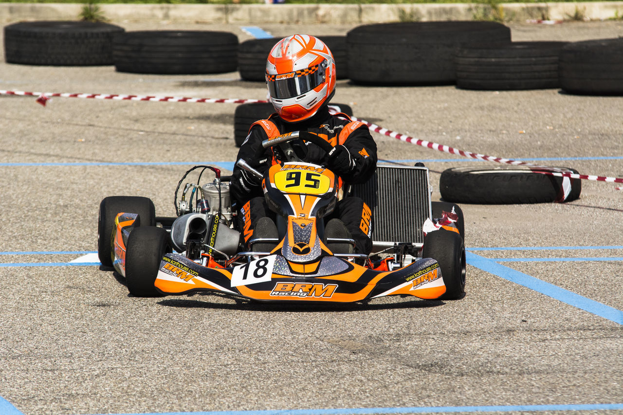 portrait of a go kart at a public event held in a parking lot Auto Racing Competition Crash Helmet Day Driving Finish Line  Formula One Racing Headwear Motor Racing Track Motorsport Outdoors People Racecar Speed Sport Sports Race Sports Track Starting Line Two People