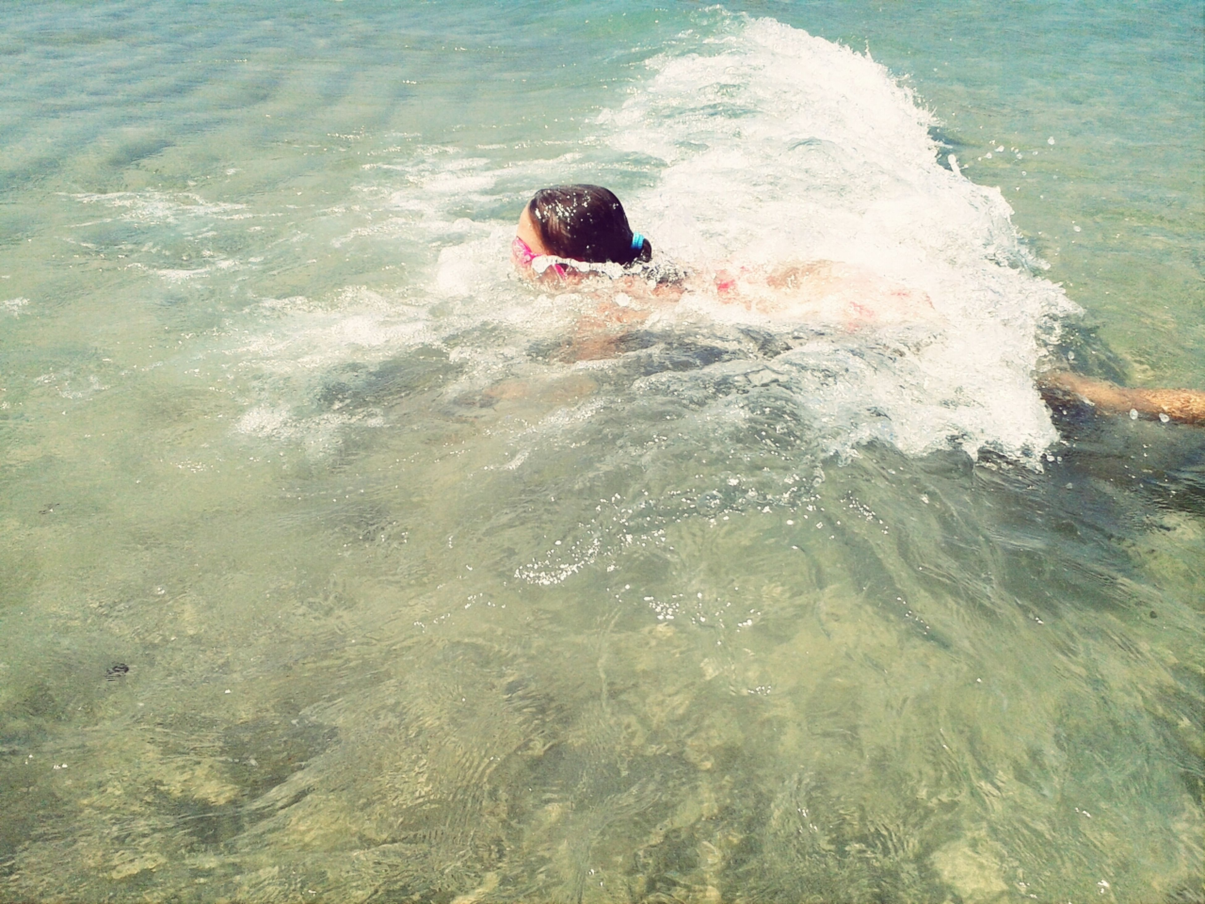water, sea, swimming, wave, waterfront, high angle view, animal themes, rippled, splashing, one animal, surf, motion, bird, animals in the wild, nature, wildlife, day, outdoors, one person, beauty in nature