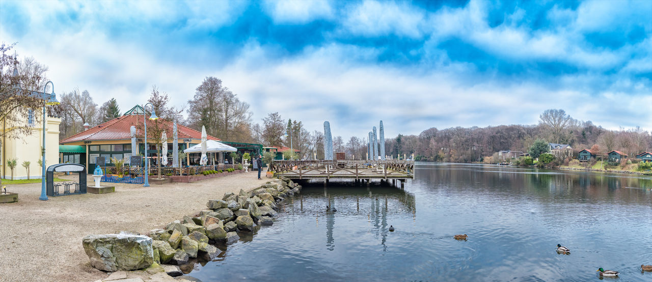 BRUEGGEN, GERMANY - JANUARY 01, 2017: The sun shines on the piecful panorama of Lake Harik - Grand hyperrealistic panorama of Hariksee Blue Sky Brueggen Brunette Cloud - Sky Day Germany Grand Panorama Hariksee High Resolution Hyperrealism Photography Lake Harik Landscape Nature Nature No People Northrhein Westfalia NRW Outdoors People Sky Tranquility Tree Trvel Destination Water Weekend Destination