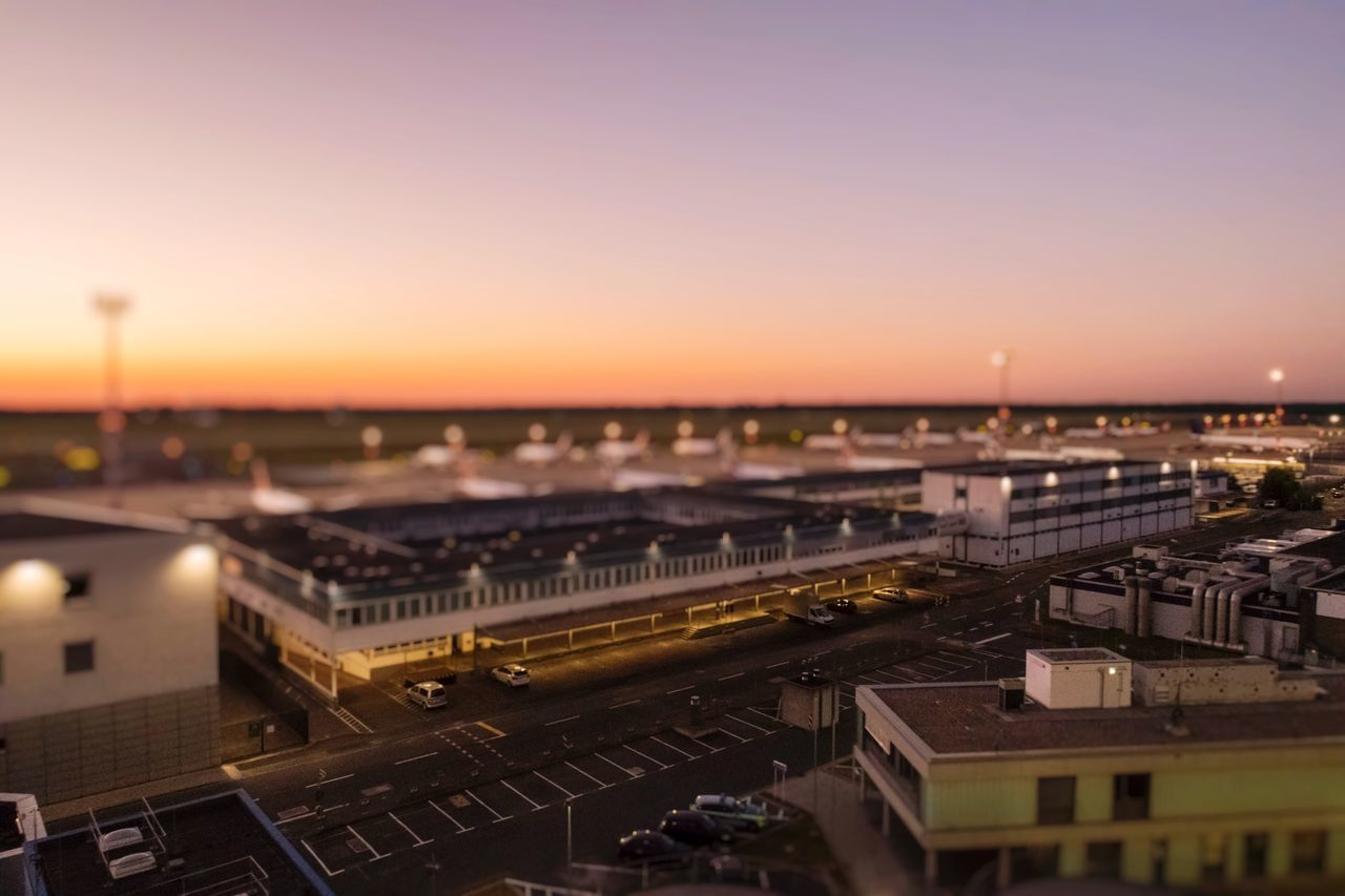 DUS Airport as seenfrom the Top of the P7 Parking Deck Architecture City Cityscape Built Structure High Angle View Sunset Building Exterior Transportation No People Outdoors Sky Night Tilt-shift Transportation Airport Airplane Airportphotography