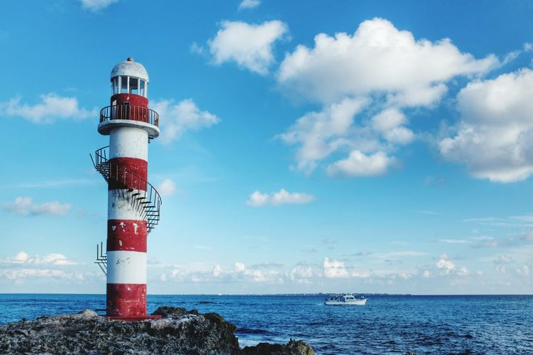 Lighthouse Sea Sky Tower Cloud - Sky Water Horizon Over Water Vacations Scenics Outdoors Boat Sailing Sailing Boat Sailing Away Building Exterior Protection Architecture Wave Nature Day Sailing Ship Caribbean