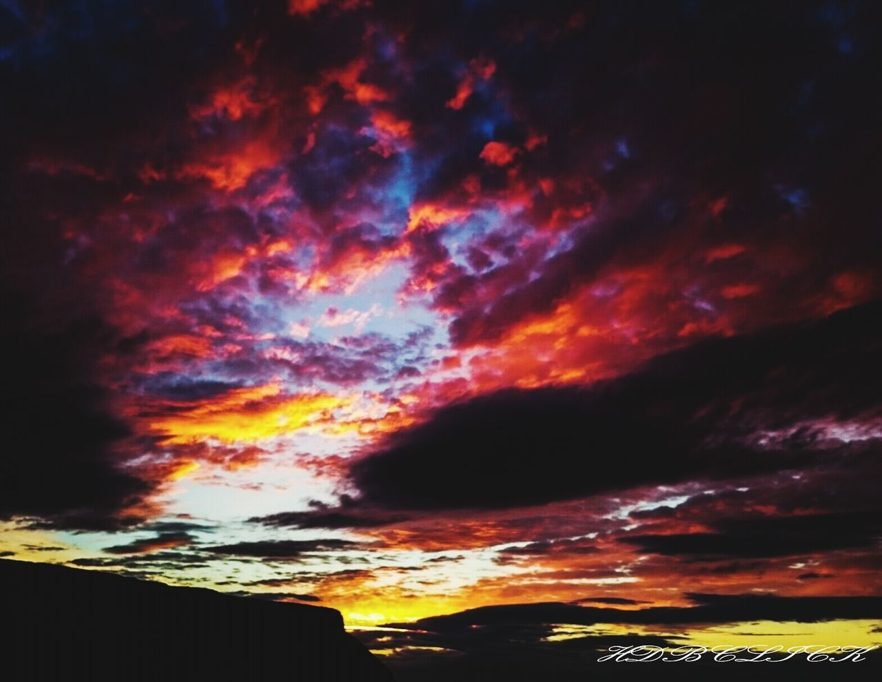 sunset, beauty in nature, scenics, nature, sky, cloud - sky, dramatic sky, tranquil scene, tranquility, no people, outdoors, silhouette, awe, low angle view, multi colored, night