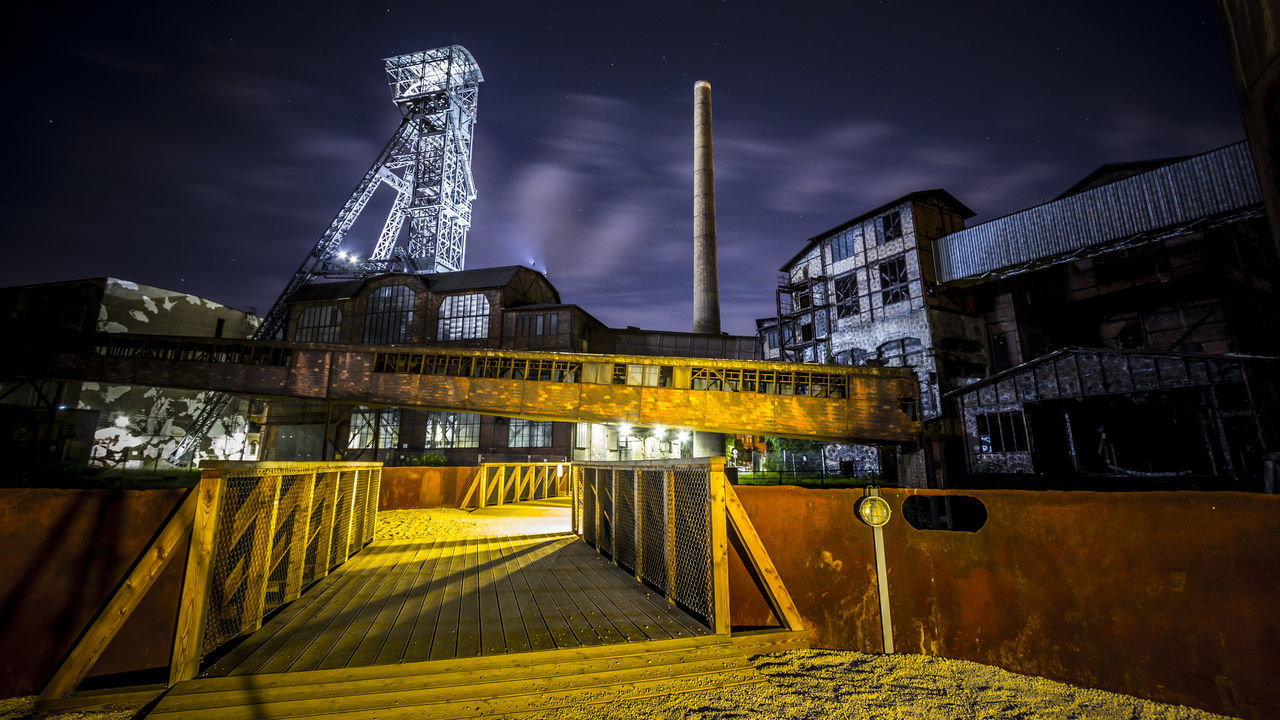 Architecture Bridge - Man Made Structure Built Structure City Cloud - Sky Coalmine Dolni Oblast Vitkovice Dramatic Sky Factory Building Futuristic Illuminated Industry In City Industry Vs Nature Long Exposure Low Angle View Night Night Sky No People Outdoors Sky Steel Factory Vitokovice