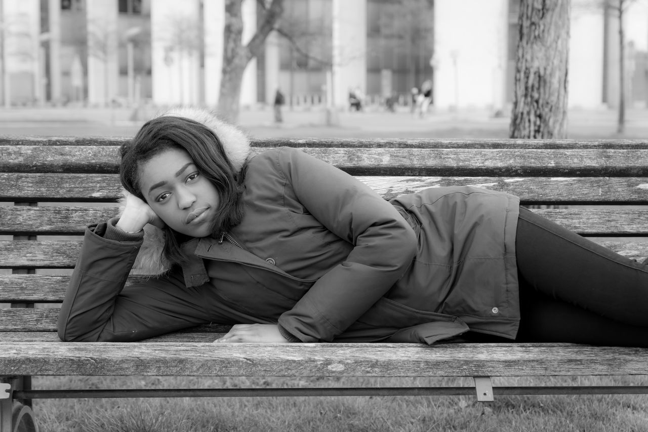 Architecture Black & White Black And White Building Exterior Built Structure Day Full Length Lifestyles Looking At Camera One Person Outdoors People Portrait Real People Sitting Tensed The Portraitist - 2017 EyeEm Awards Young Adult Young Women