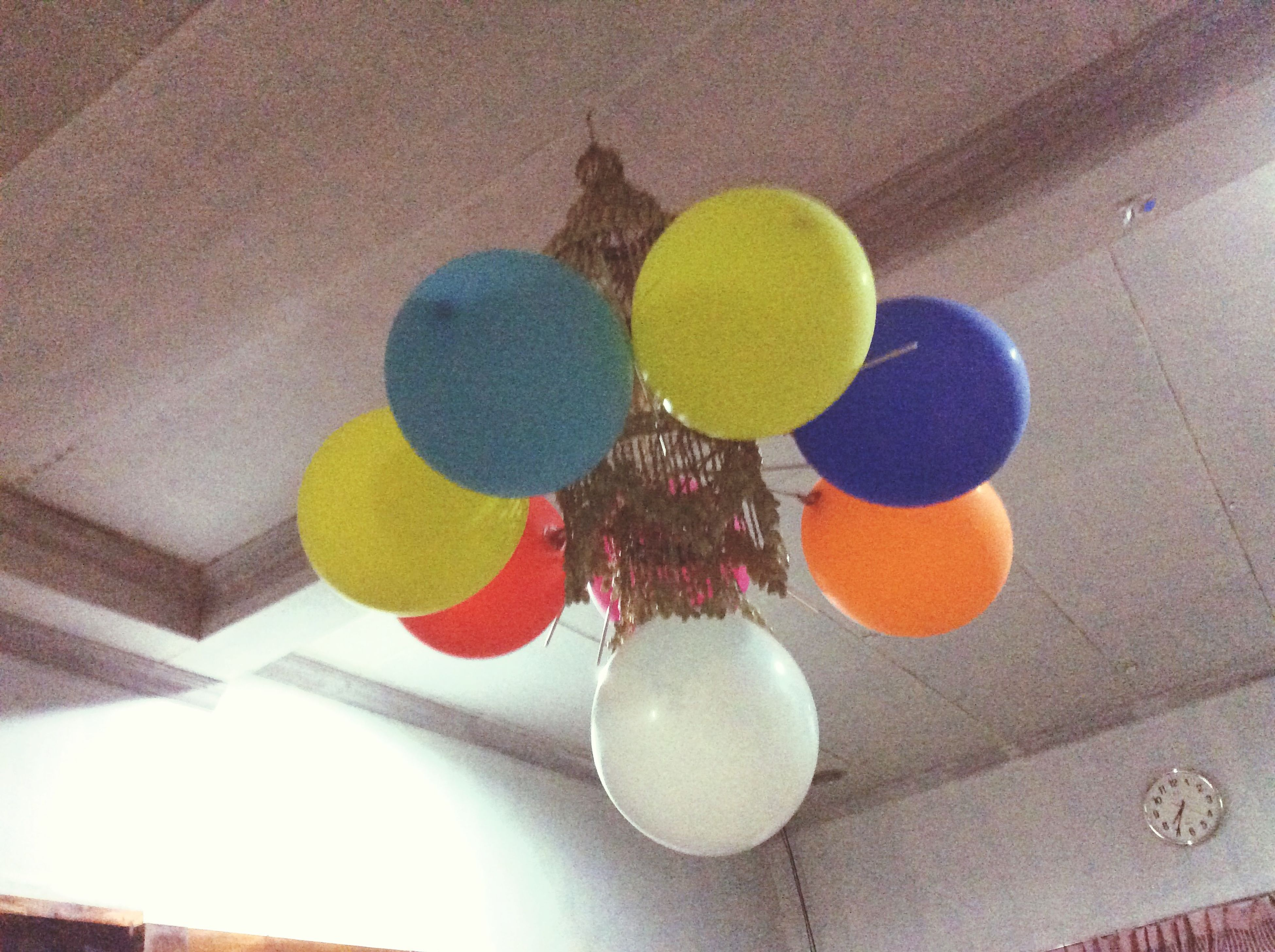 indoors, decoration, multi colored, table, still life, high angle view, variation, celebration, home interior, hanging, no people, wall - building feature, yellow, flooring, art and craft, arrangement, creativity, art, balloon, colorful