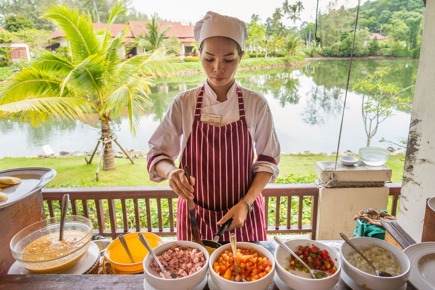 Trat, Thailand - May, 21, 2017 : Unidentified name woman chef was making scrambled eggs for breakfast at the restaurant of Klong Prao Resort in Koh Chang island Trat, Thailand. Background Chef Cooking Cuisine Editorial  Egg Illustrative Illustrative Editorial Launch Thailand