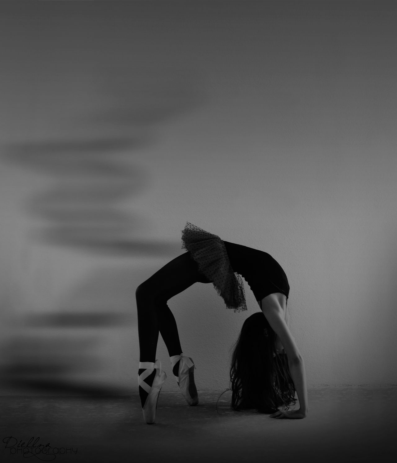 This picture consist an unusual ballerina with her hair untied, showing sadness while she doesn't stop the dance, meaning she doesn't stop living even though she's facing a deep sadness. Ballerina Ballet Black And White Conceptual Conceptual Photography  Contemporary Contemporary Art Dance Dancing Girl Hair Photographer Photography Sadness First Eyeem Photo