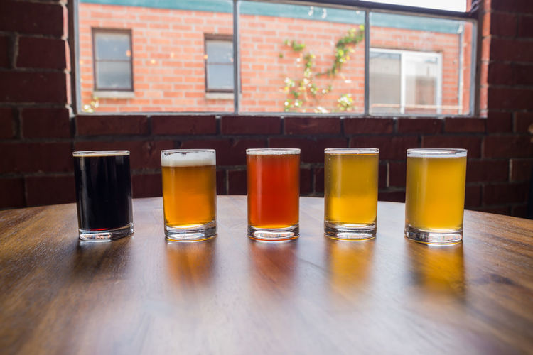 Beer Sampler Alcohol Alcoholic Drink Arrangement Beer Beer Sampler Beer Time Beers Brewery Close-up Day Drink Drinks Empty Group Of Objects Happy Hour In A Row Multi Colored No People Orange Color Restaurant Side By Side Still Life Yellow