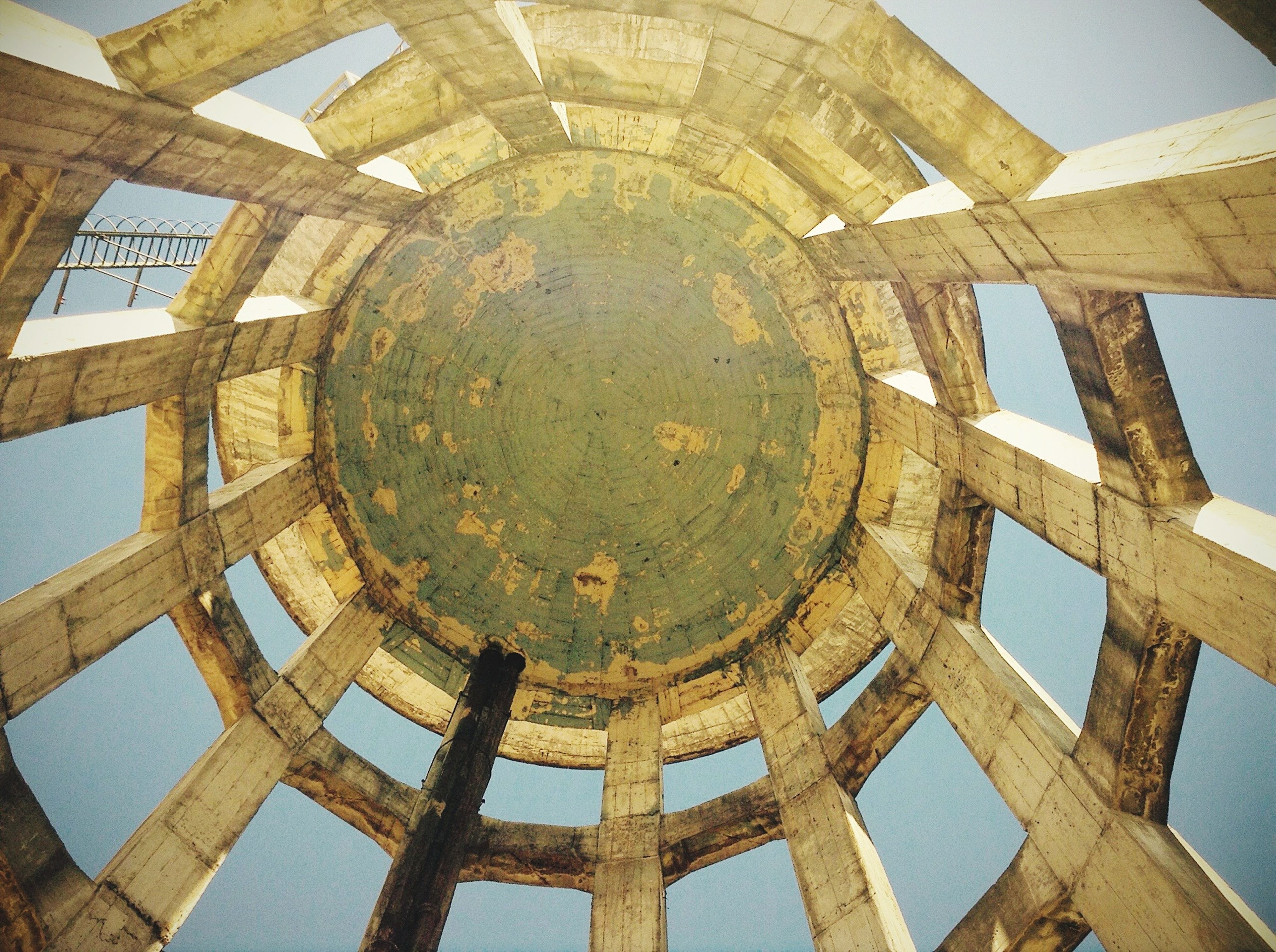 architecture, built structure, low angle view, old, history, abandoned, damaged, indoors, deterioration, obsolete, circle, weathered, building exterior, run-down, the past, metal, old ruin, geometric shape, no people, day